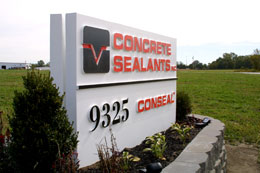 Double-sided precast concrete commercial sign